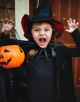 Little girl dressed up as a witch