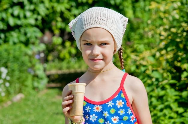 Little girl eating ice cream in the park