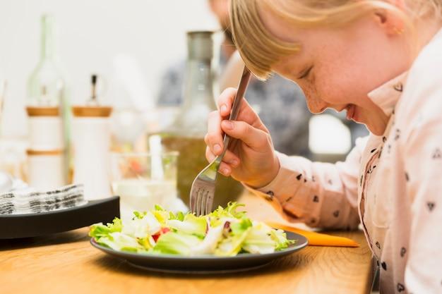 Little girl eating tasty dish