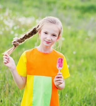Little girl eats ice-cream in the summer
