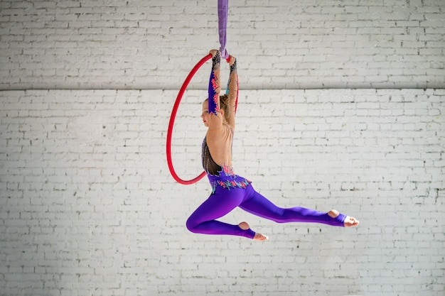A little girl engaged in aerial gymnastics