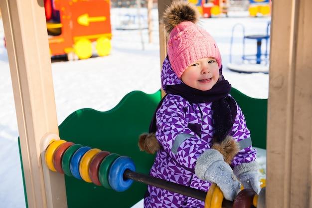 Little girl enjoying beautiful winter day outdoors