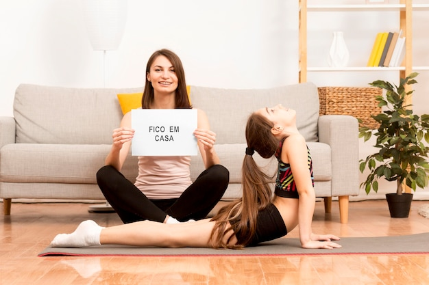 Little girl exercising with mom