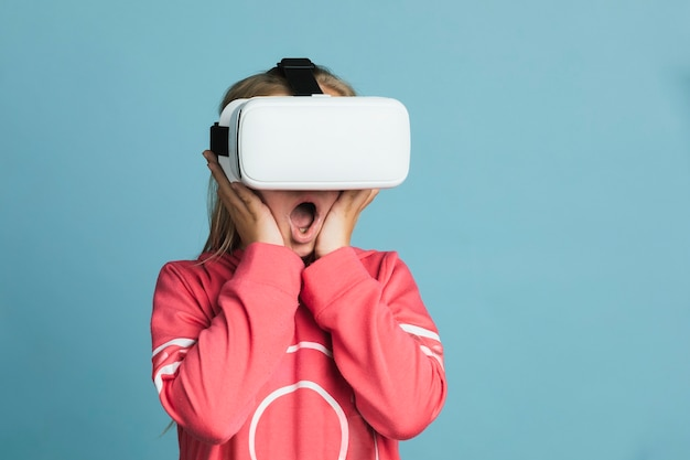 Little girl experiencing a vr headset