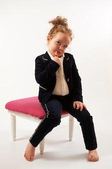 Little girl fashion model in black suit