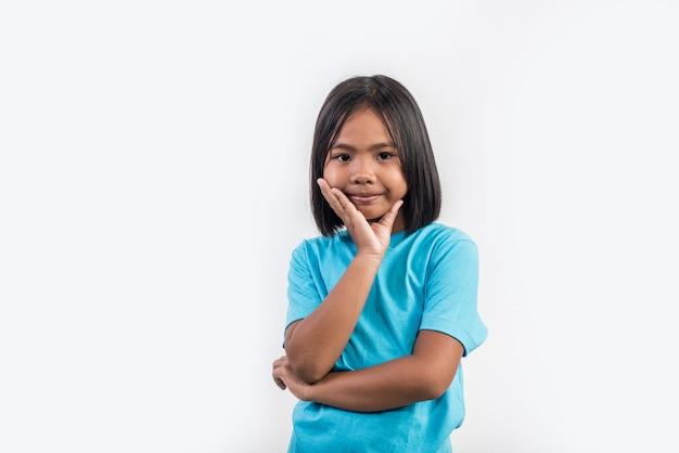 Little girl feel angry in studio shot