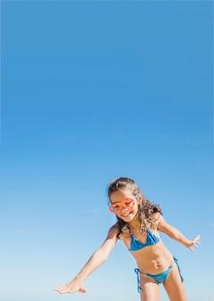 Little girl finding something on the beach