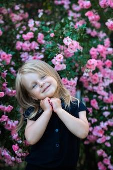 Little girl in the flower garden