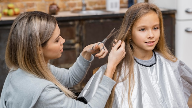 Little girl getting her hair done