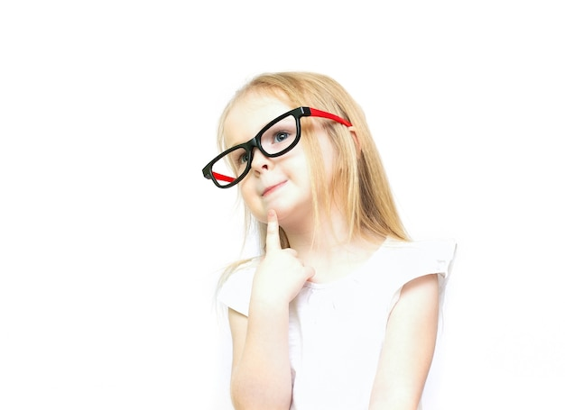 Little girl in glasses is thinking