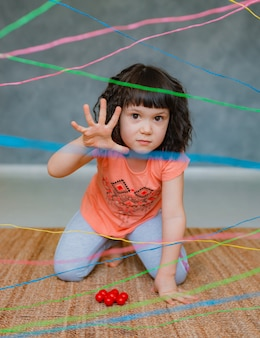Little girl going through a rope web