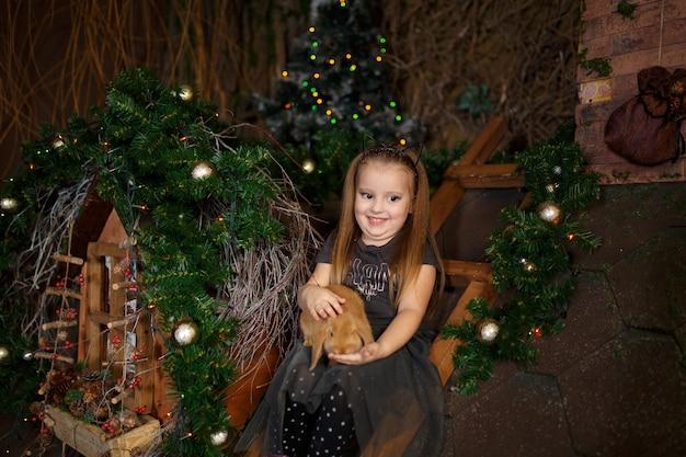 Little girl got a rabbit for present on christmas