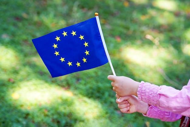 Little girl hands hold flag