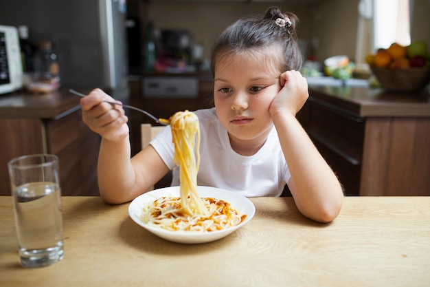 Little girl not happy with pasta dish
