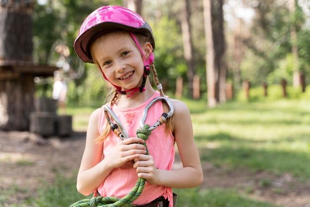Little girl having fun at an adventure park