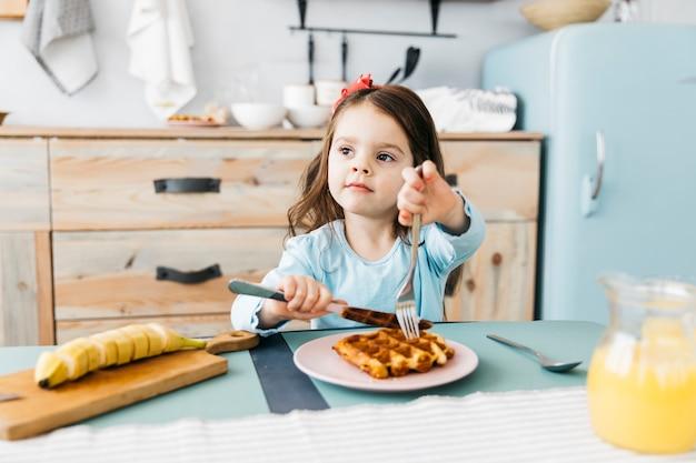 Little girl having her breakfast