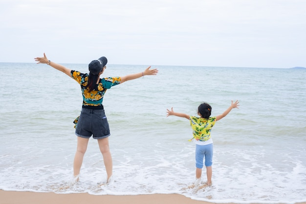 Little girl and her mother during beach vacation