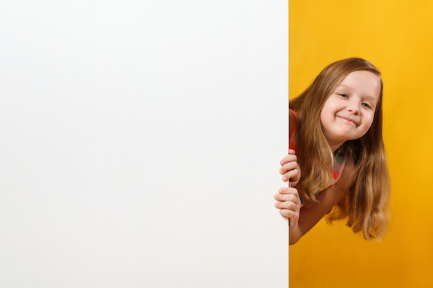 Little girl holding a blank white space background