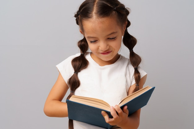 Little  girl  holding a book in her hands