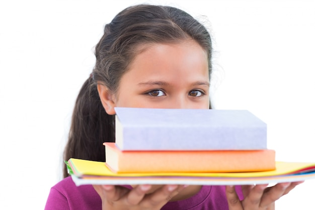Little girl holding her homework and looking at camera