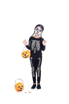 Little girl holding jack o lantern pumpkin basket