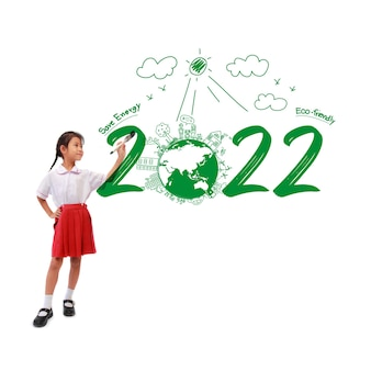 Little girl holding a paint brush painting creative environmental and eco-friendly, save energy 2022 new year