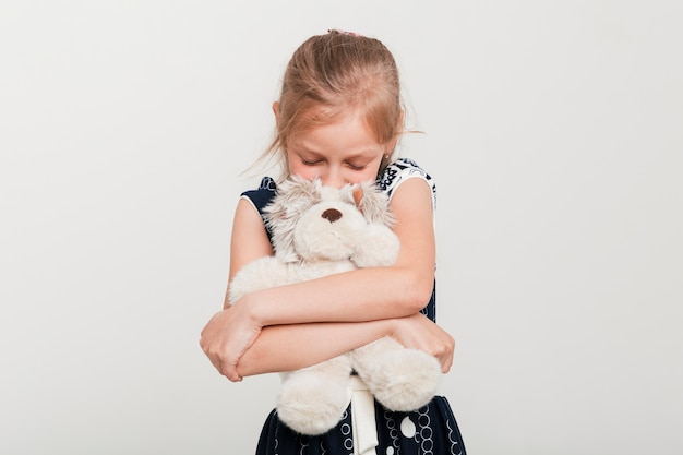 Little girl hugging her teddy
