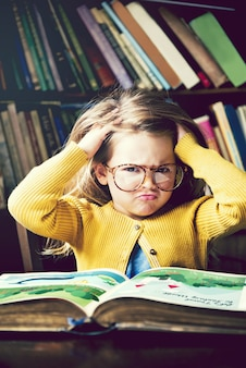 Little girl immersed in books