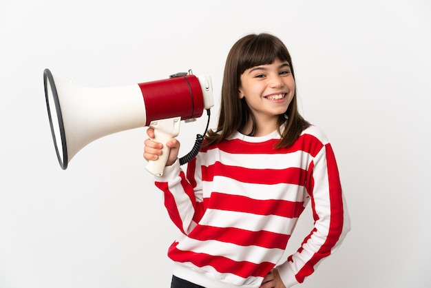 Little girl isolated holding a megaphone and smiling Premium Photo