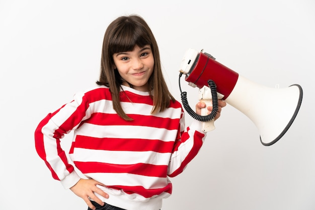 Little girl isolated on white background holding a megaphone and thinking