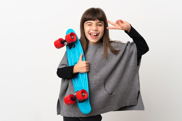 Little girl isolated with a skate with happy expression