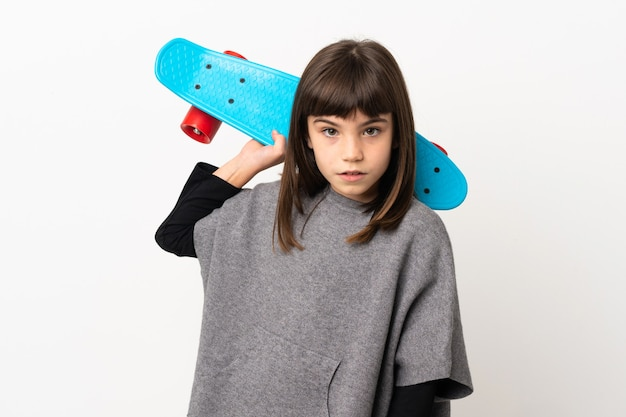 Little girl isolated with a skate