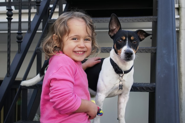 Little girl and jack russel dog