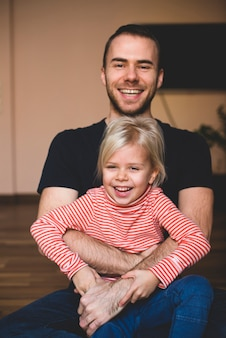 Little girl laughing with her father
