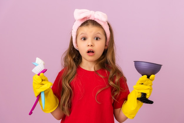 A little girl likes to keep the house clean. hygiene and cleanliness in the house.