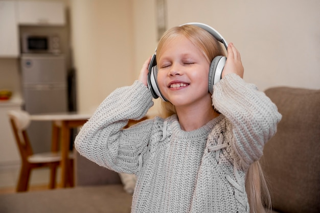 Little girl listening to music concept