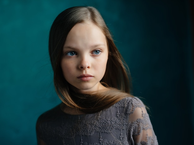 Little girl long hair posing green background