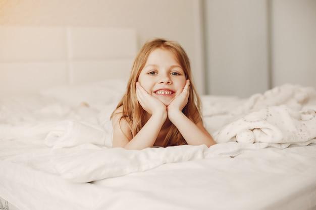 Little girl lying in a bad