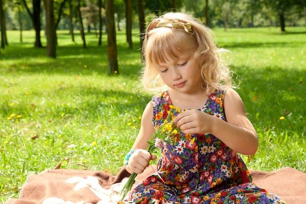 Little girl making a bouquet