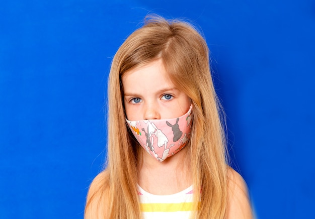 Little girl in a medical mask. mask prophylaxis to reduce the spread of coronavirus outbreaks (covid-19)