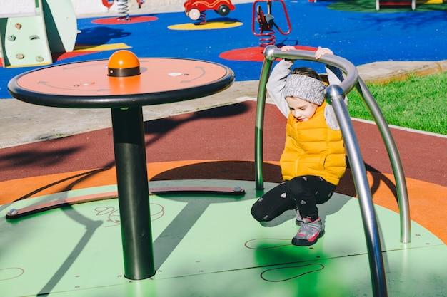Little girl on merry-go-round