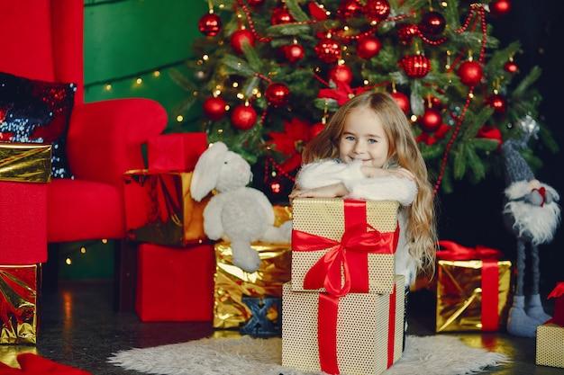 Little girl near christmas trre