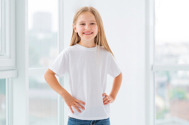 Little girl in new white clothes