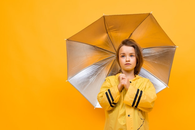 Little girl under an open umbrella