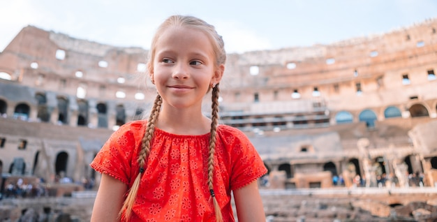 Little girl outdoors in coliseum, rome, italy,