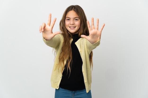 손가락으로 8 세 고립 된 흰색 위에 어린 소녀