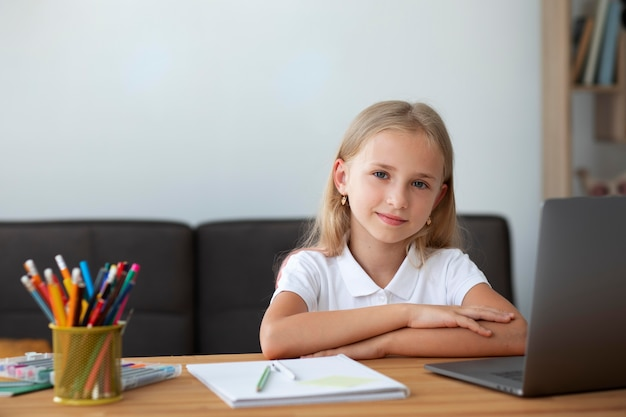 Little girl participating in online classes at home