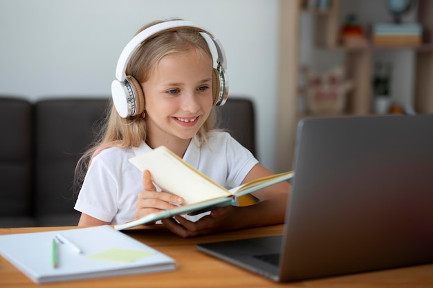 Little girl participating in online classes