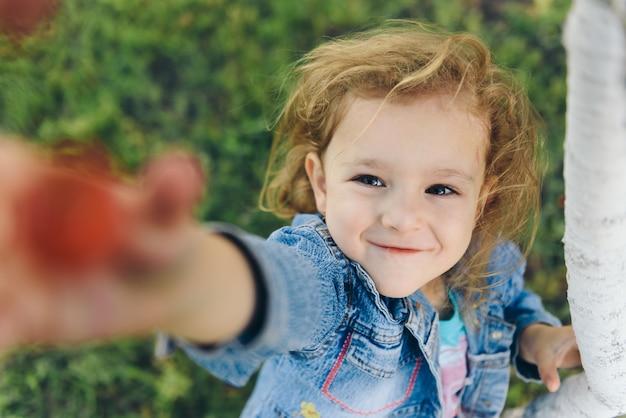 Little girl picking cherry