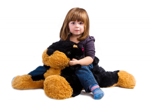 Little girl play with her plush dog
